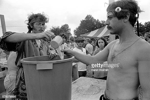 A man serves a beverage at the Woodstock Music Art Fair Bethel NY August 15 1969