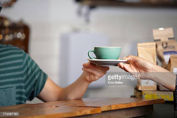 Man serving a cup of coffee