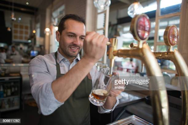 Man serving beer at a pub