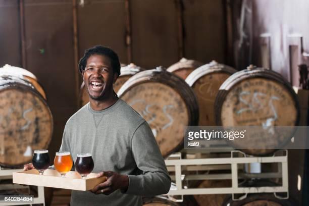 Man serving beer at microbrewery