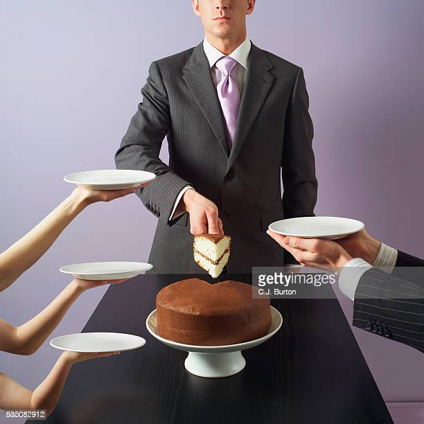 Man serving cake slices to waiting people