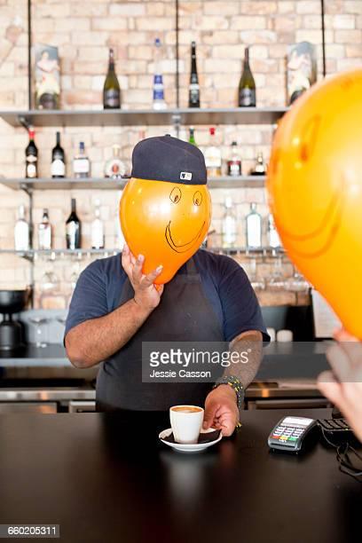 Man serving coffee