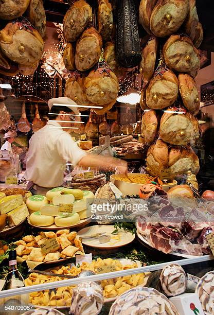 Man serving in a traditional food shop in Bologna