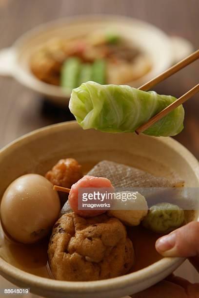 man serving oden in bowl, close-up - oden fotografías e imágenes de stock