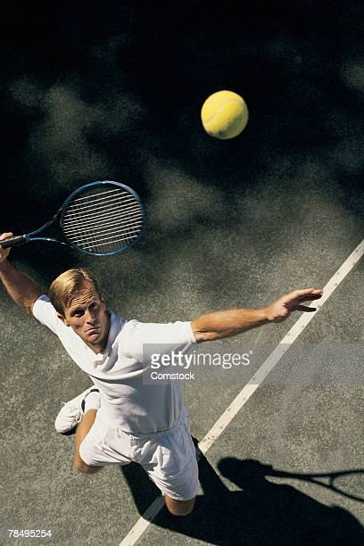 man serving tennis ball - human limb stock pictures, royalty-free photos & images