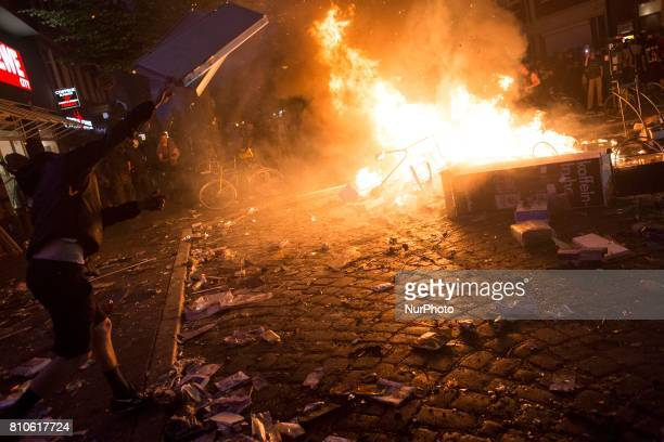 Man set a fire during riots in St Pauli district during G 20 summit in Hamburg on July 8 2017 Authorities are braced for largescale and disruptive...
