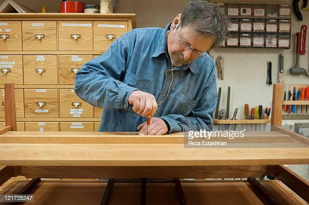 Man sets final details on table