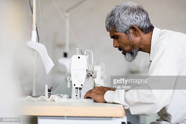 man sewing - hugh sitton india stock pictures, royalty-free photos & images