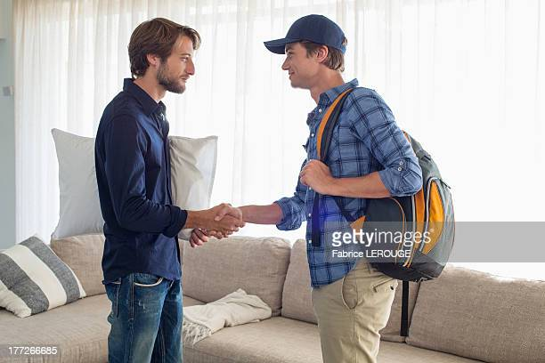 Man shaking hands with his friend