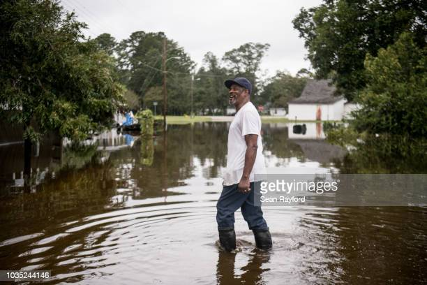 Man shares a laugh with a neighbor on September 17 in Dillon, South Carolina. Many rivers in the Carolinas are approaching record flood stages due to...