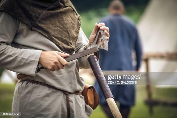 Man sharpening an ax Festival of Slavs and Vikings Centre of Slavs and Vikings JomsborgVineta Wolin island Poland Slavic and Viking civilisation...