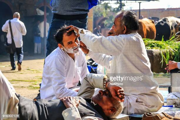 A man shave his beard at Khushwa Ghat in Haridwar Uttrakhand India on 8th Feb 2018According to hindu culture Har ki Pauri one of the famous ghat and...