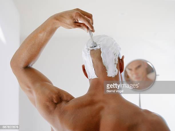 Man shaving head