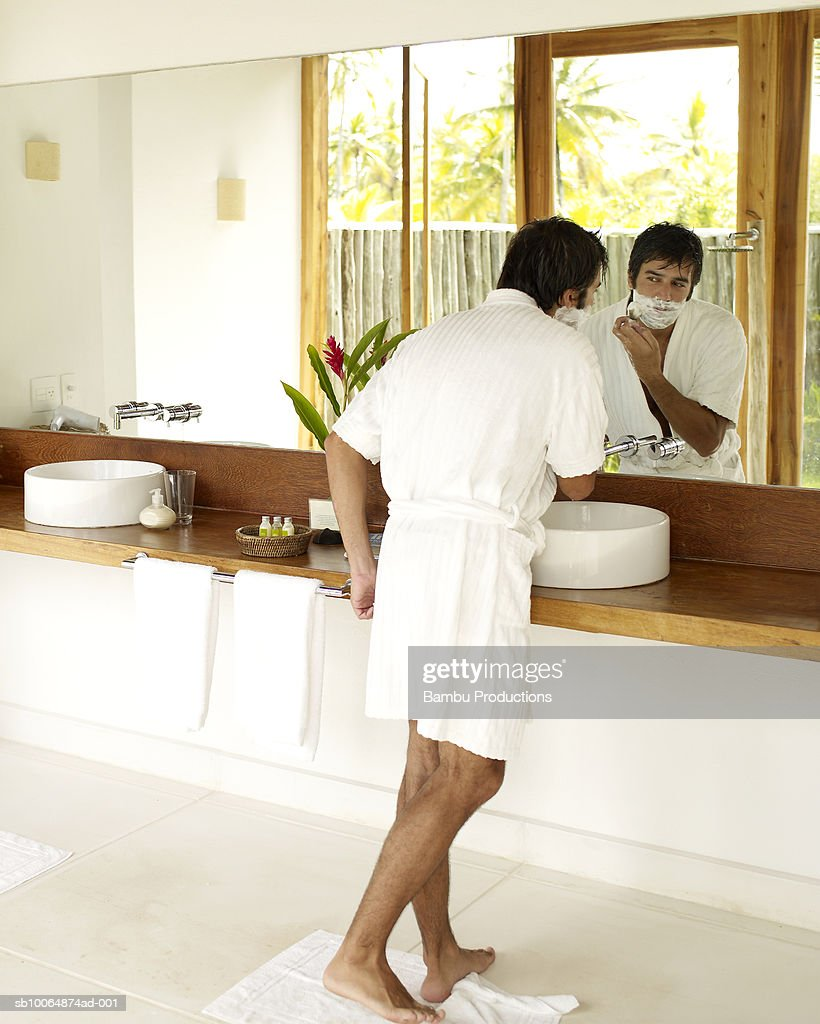 Man Shaving In Bathroom Mirror Stock Photo | Getty Images