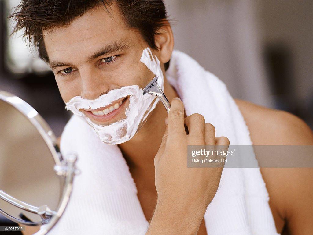 Man Shaving in Bathroom : Stock Photo