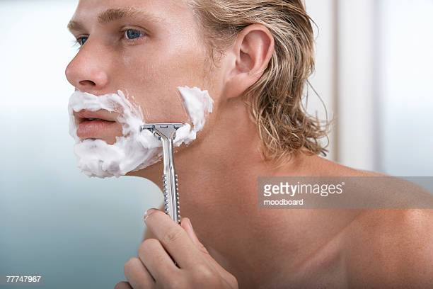 man shaving - razor stock photos and pictures