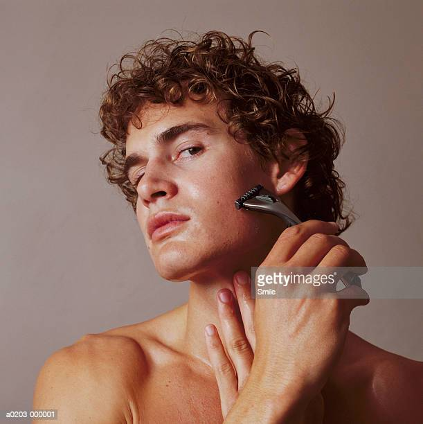 man shaving - shaving stock pictures, royalty-free photos & images