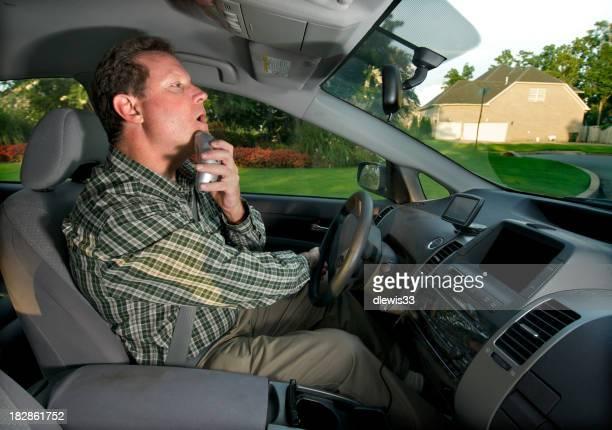 Man Shaving While Driving