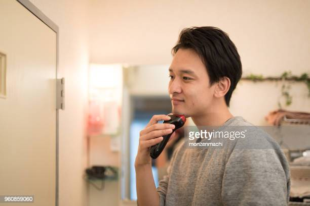 man shaving with shaver - stubble stock pictures, royalty-free photos & images