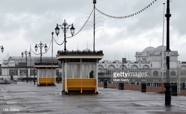 Man shelters from the wind and the rain on June 11, 2012 in Southsea, England. The Met Office has issued severe weather warnings for England and...