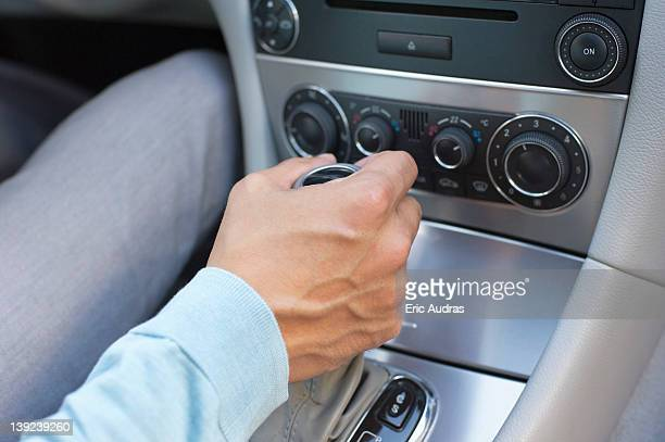 Man shifting automatic car gear