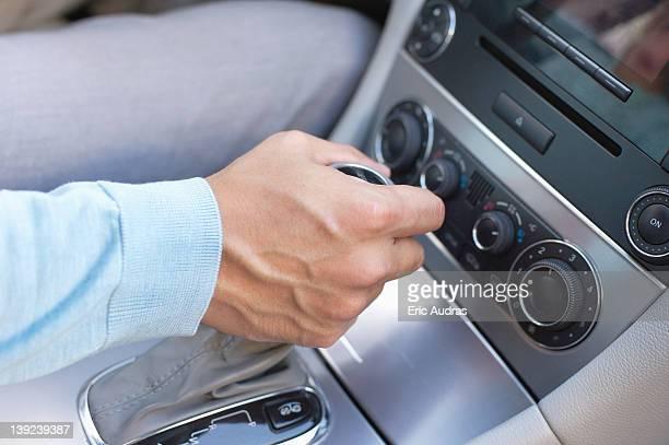 Man shifting automatic car gear