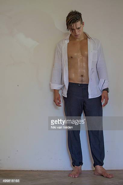 Man shirt open face down