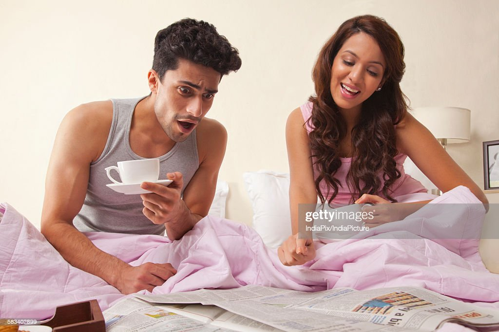 Man shocked while reading article in newspaper : Stock Photo
