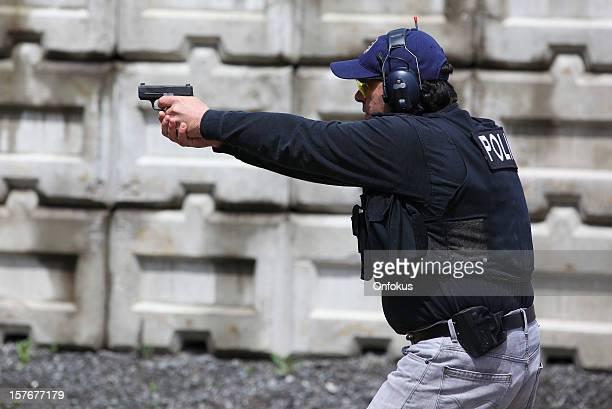 man shooting 9mm handgun shooting range - target shooting stock pictures, royalty-free photos & images