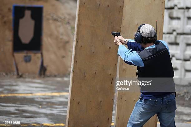 Man Shooting 9mm Handgun Shooting Range