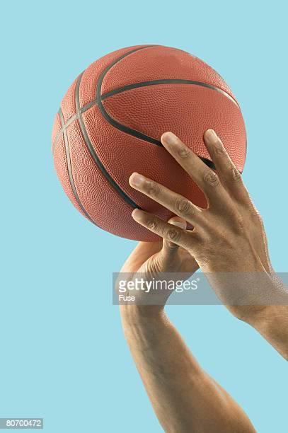 Man Shooting a Basketball