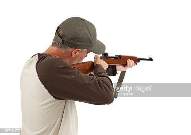 man shooting a rifle - rifle stock pictures, royalty-free photos & images