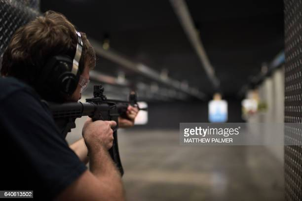 man shooting assault rifle - ar 15 stock pictures, royalty-free photos & images