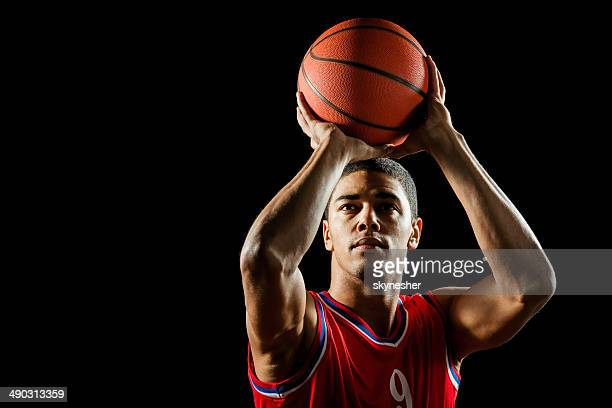 man shooting at the hoop. - basketball player stock pictures, royalty-free photos & images