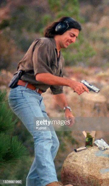 man shooting pistol in california desert - gun control stock pictures, royalty-free photos & images