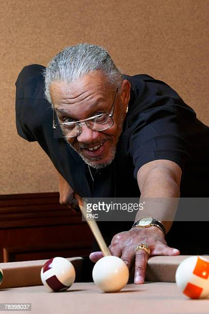 man shooting pool - old men playing pool stock pictures, royalty-free photos & images