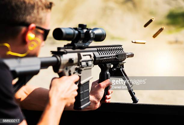man shooting rife - rifle stock pictures, royalty-free photos & images