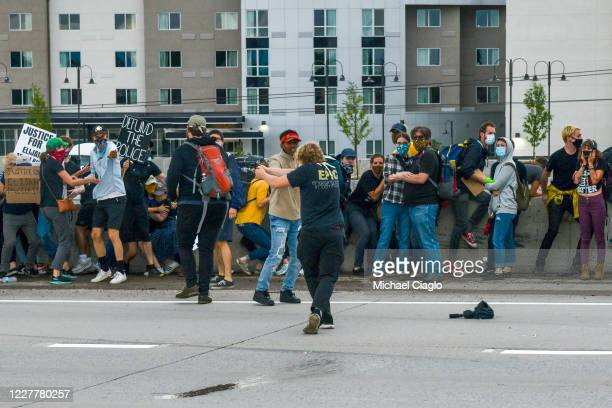 A man shoots at a Jeep speeding through a crowd of people protesting the death of Elijah McClain on I225 on July 25 2020 in Aurora Colorado On August...