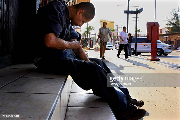 A man shoots heroin on a street corner in the Zona Norte 'Red Light' district of Tijuana Mexico on August 22 2009 The Mexican government has...