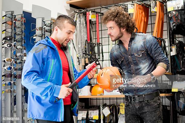 man shopping alpine equipment - climbing equipment stock pictures, royalty-free photos & images