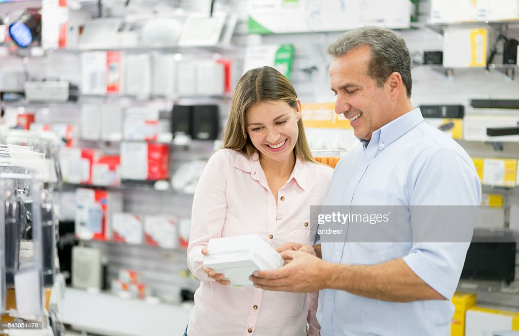 Man shopping at a tech store : Stock Photo