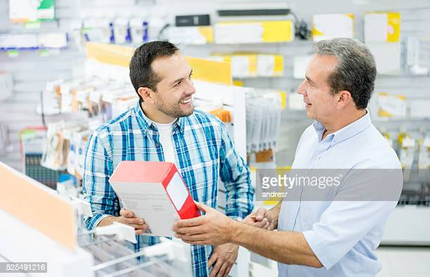 man shopping at an electronics store - electronics store stock photos and pictures