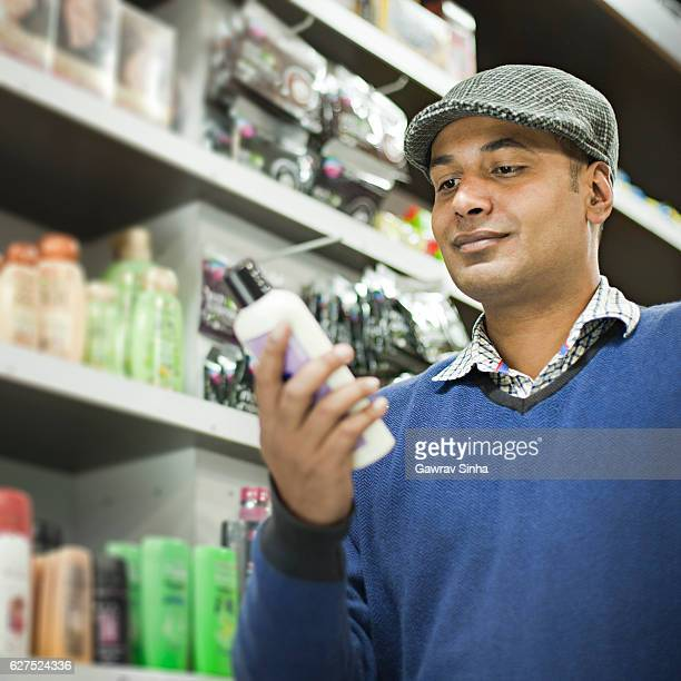 Man shopping at supermarket.