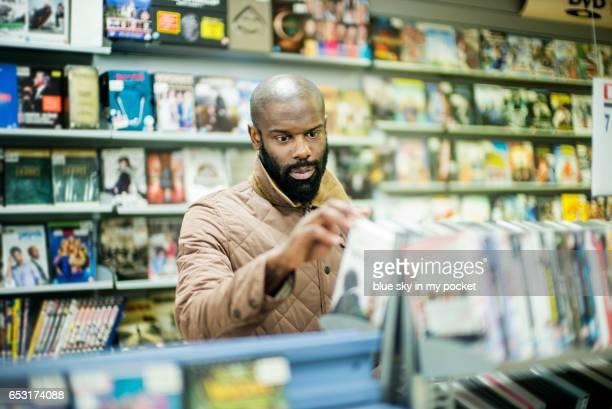 A man shopping for DVD films.