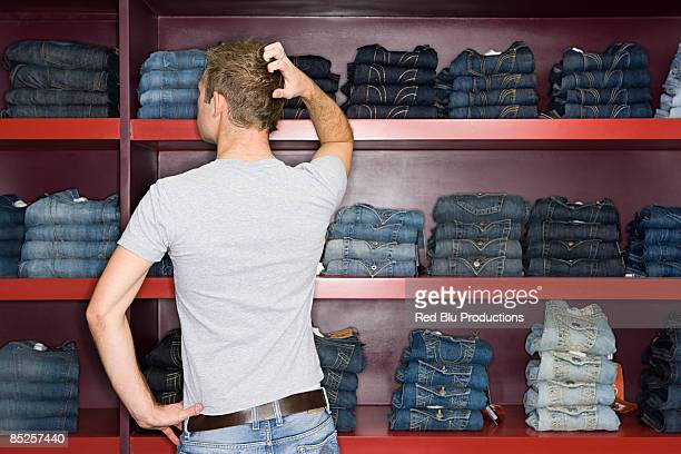man shopping for jeans - trousers stock pictures, royalty-free photos & images