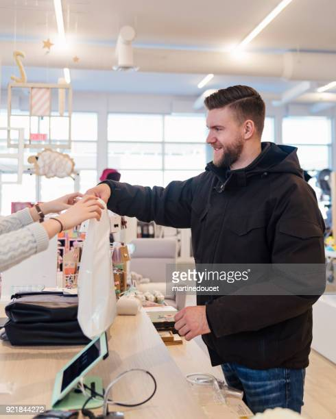 Man shopping in a children store ready to go.