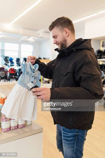 Man shopping in a children store ready to pay.