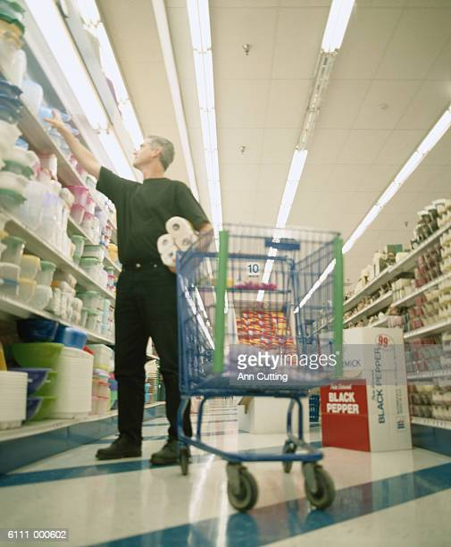 man shopping in supermarket - buying toilet paper stock pictures, royalty-free photos & images