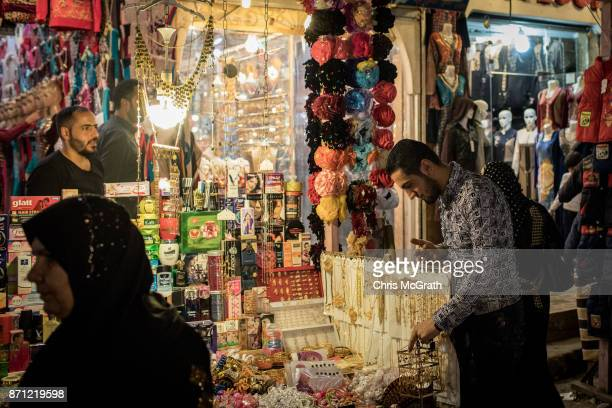 A man shops at a store inside the Prophet Younis market in East Mosul on November 5 2017 in Mosul Iraq Five months after Mosul Iraq's secondlargest...