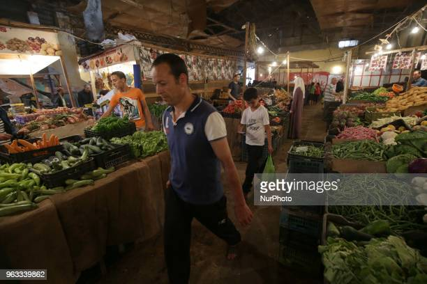 A man shops at a vegetable market during the holy month of Ramadan in Algiers Algeria on May 27 2018